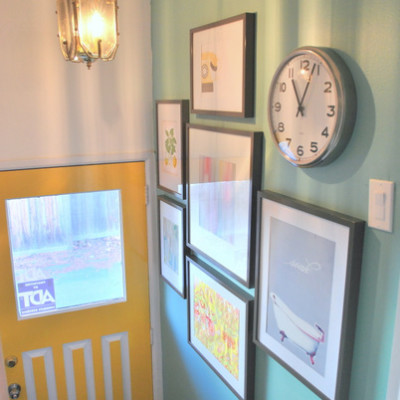 an entryway gallery wall