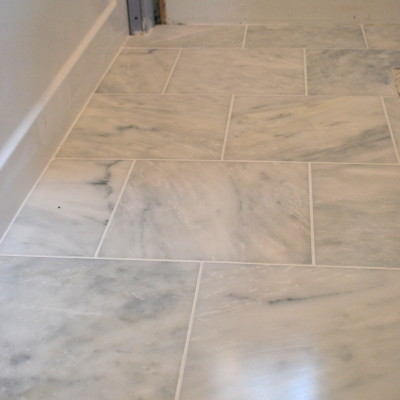 tile + grout a marble floor
