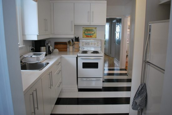 Black And White Kitchen Floor how to lay vinyl black and white flooring (in stripes!) - the