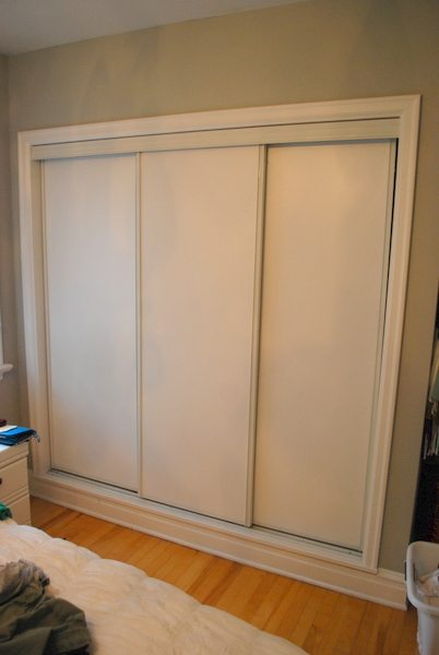 Painted sliding closet doors faux trim effect the for Sliding closet doors