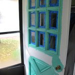 A painted turquoise front door on a red brick bungalow. A perfect DIY project to amp up your curb appeal! - via the sweetest digs
