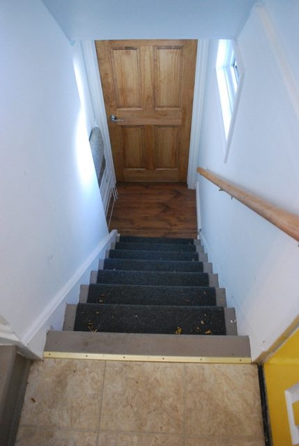 basement stairs looking down. And the second part of staircase  which leads up to our main floor had nothing Just this god awful gray paint that showed every spec dirt How To Install Your Own DIY Stair Runner With IKEA Rugs