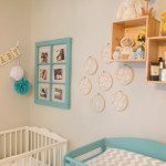 a blue and yellow baby nursery for Mae