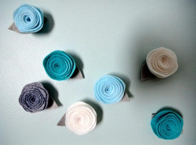 blue and purple nursery decor for a baby girl - via the sweetest digs