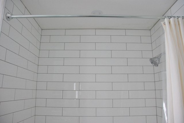 Shower Design With Subway Tile And Marble Tile Niche The