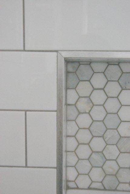 Shower Design With Subway Tile And Marble Niche The