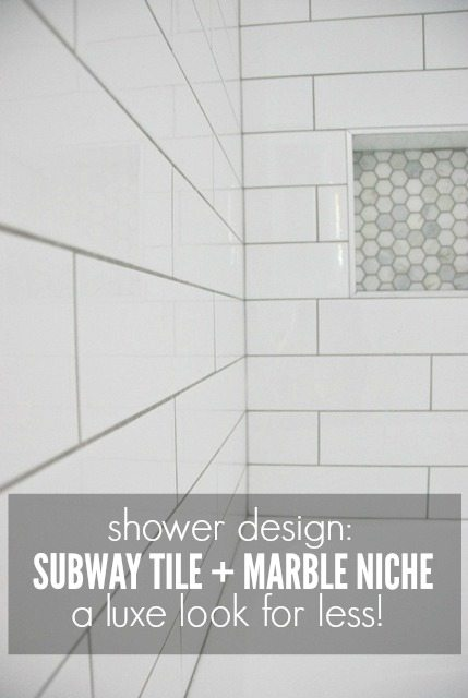 shower tile design using white subway tile and marble tile niche