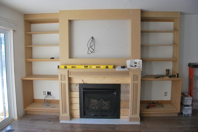 Want to build DIY fireplace built ins? See the play-by-play of how our craftsman style built ins were created using MDF