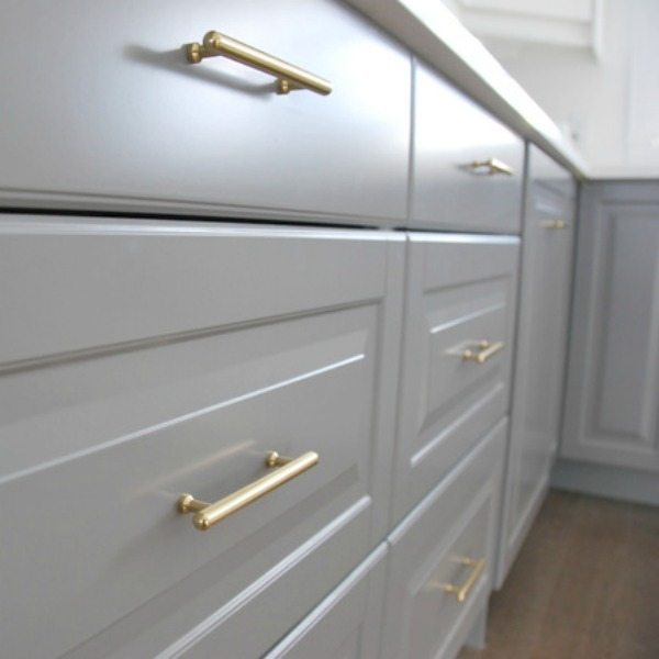 gold kitchen cabinetry hardware - via the sweetest digs