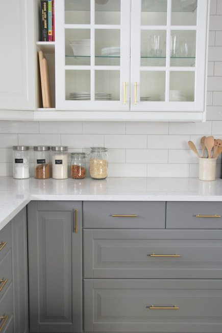 grey and white kitchen with white subway tile