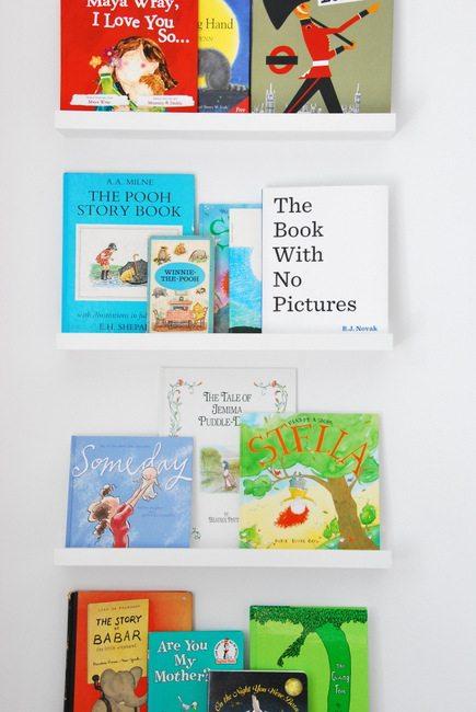 make kids bookshelves using IKEA ribba picture ledges - via the sweetest digs