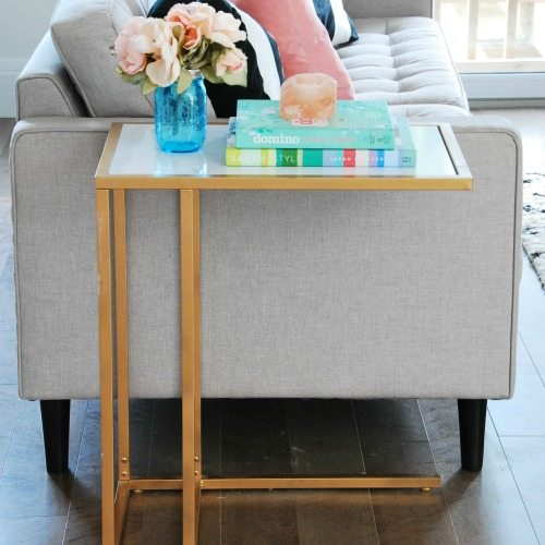 Amazing DIY! turn the IKEA Vittsjo laptop table into a chic gold and marble side table - via the sweetest digs