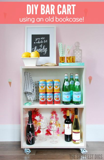 Transform an old bookcase using stain, paint and casters to make a chic DIY bar cart - via the sweetest digs