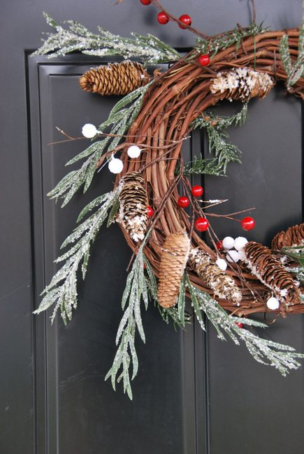Want to make a winter wreath for your front door? Here is the easiest DIY rustic Christmas wreath EVER. Uses a grapevine base and features pinecones, berries, and flocked greenery. So pretty! Head on over to the blog for the full how-to tutorial!