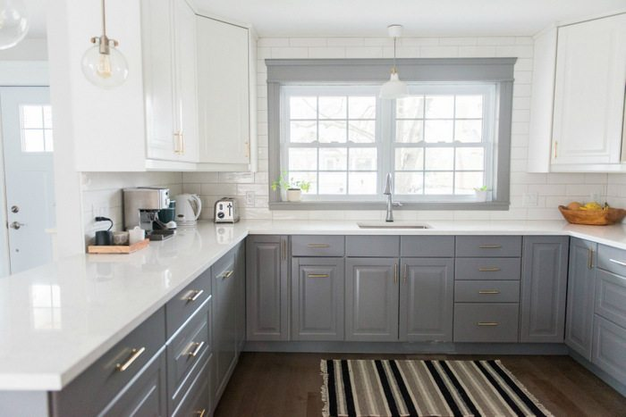 A gray and white kitchen makeover using IKEA cabinetry, quartz countertops, subway tile, and gold hardware. Click through for the full source list & how-to's!2