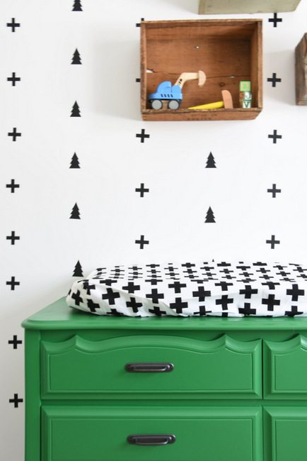 Looking for nursery or kids room decor ideas? Check out this black, white, and green boys room with a scandi meets camp design. Using swiss cross and tree wall decals, a painted dresser, and more! Click through for the how-to tutorial on the blog.