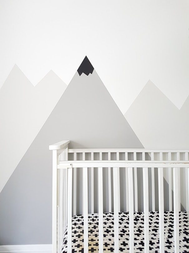 How to paint a #DIY #mountain #mural for a #kids #room or #nursery. Big impact on a budget! Great nursery decorating idea.