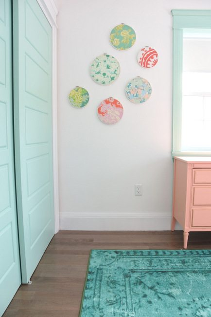 Decorating a baby girls nursery - This mint and pink room is all kinds of sweet with tons of DIY project ideas and budget-friendly decor items.7