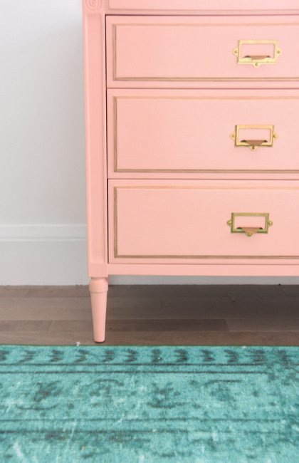 Decorating a baby girls nursery - This mint and pink room is all kinds of sweet with tons of DIY project ideas and budget-friendly decor items.8