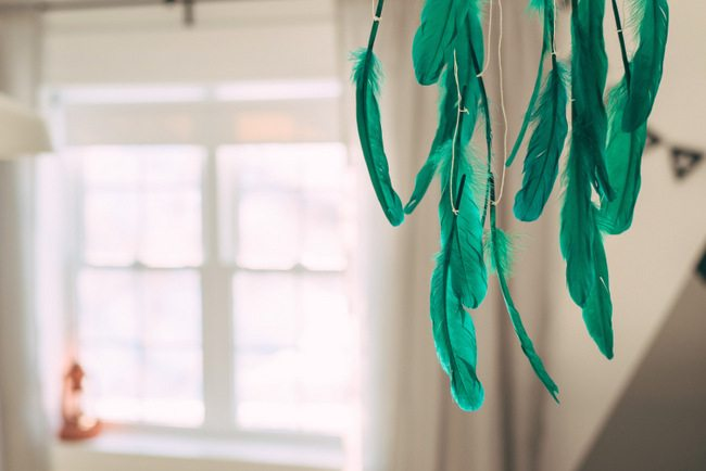 Make this DIY feather mobile in under 10 minutes! AND it costs less than $10 with supplies from the dollar store. Perfect for a nursery or kids room, or give as a handmade baby shower gift. Click over to the blog post for the how-to tutorial.