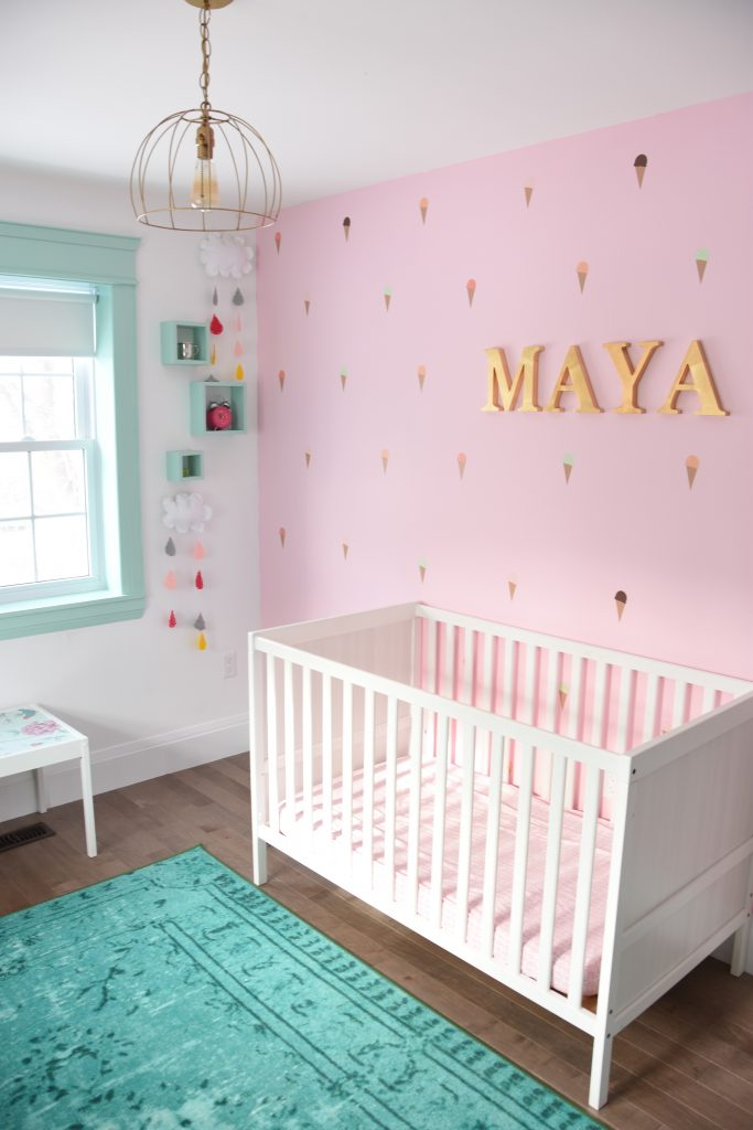 Tour this #mint and #pink #nursery. Lots of great #DIY and #kids #room #decor ideas!!