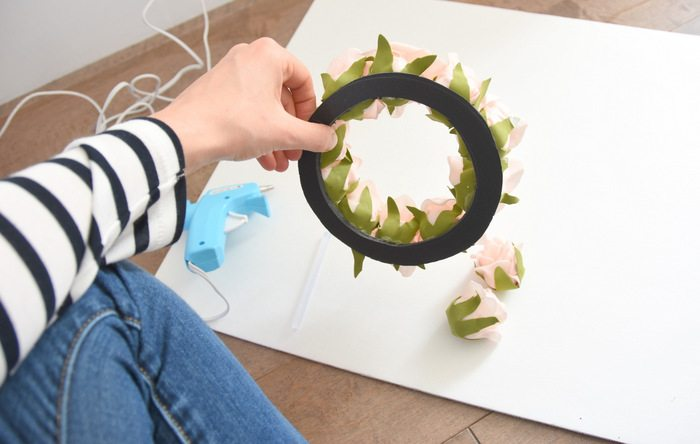 Want to make a spring or summer wreath-This sweet pink floral wreath is a simple DIY project using dollar store materials. Click through for the how-to tutorial!