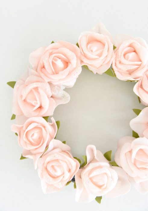 Want to make a spring or summer wreath- This sweet pink floral wreath is a simple DIY project using dollar store materials. Click through for the how-to tutorial