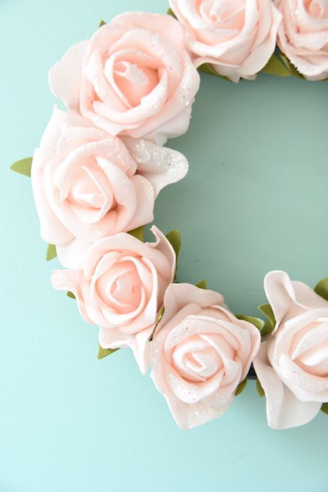 Want to make a spring or summer wreath- This sweet pink floral wreath is a simple DIY project using dollar store materials. Click through for the how to tutorial