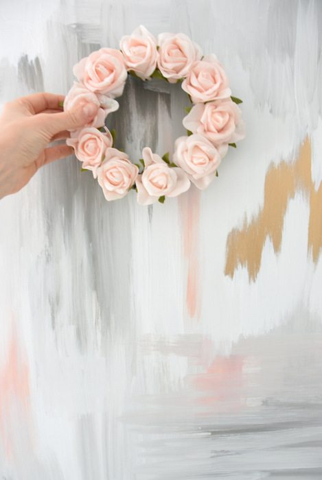 DIY Faux Floral Wreath - Want to make a spring or summer wreath - This sweet pink floral wreath is a simple DIY project using dollar store materials. Click through for the how to tutorial!