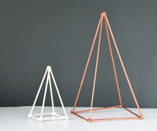Trying to figure out how to style your shelves? Make these DIY geometric triangle sculptures out of skewers, hot glue, and spray paint. Spray them white, gold, copper, or whatever color suits your decor! An easy project with super high end look. Click through for the full how-to tutorial.