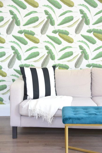 Want to get that hollywood glam, tropical, palm leaf look? Check out this banana leaf wallpaper that is a fraction of the price and removable! Makes an amazing decor statement in a living room or any space in the house. Click through to see how I installed it myself and got a high end look for less.