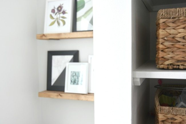 Want to make the easiest DIY floating shelves? Head over for this tutorial and whip up some faux floating shelves in wood. They even look like reclaimed wood, but are just plain lumber for less than $15! Shelves above a toilet are a perfect design trick to add some interest and art to an awkward space!