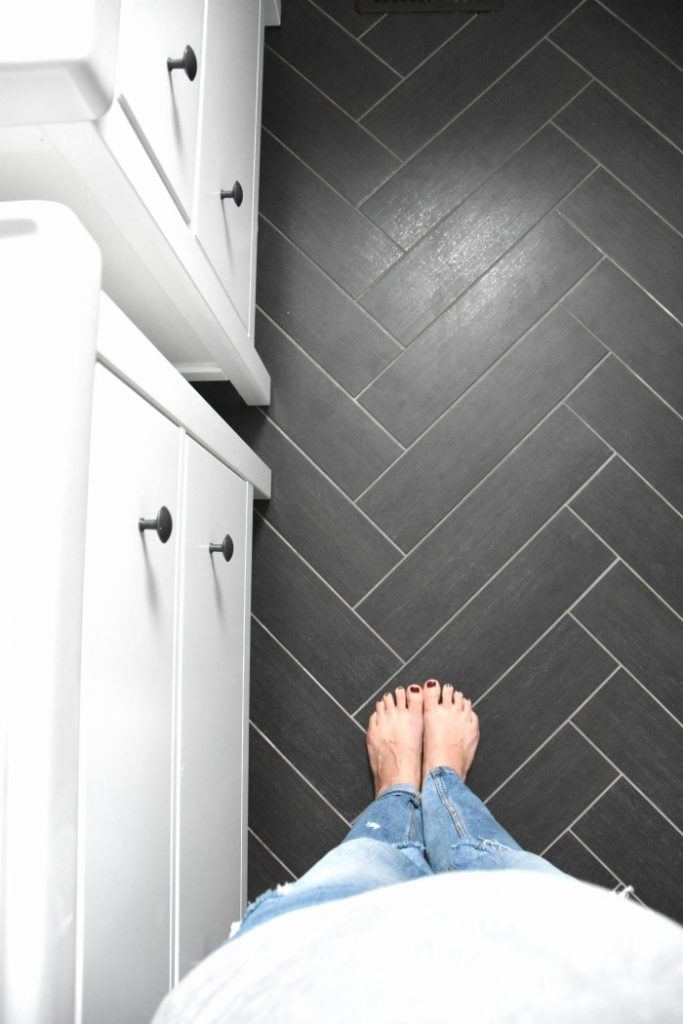 Classic gray, white, and black bathroom with herringbone tile floors | Home Decor on a budget | Copy this bathroom design - click through for sources!