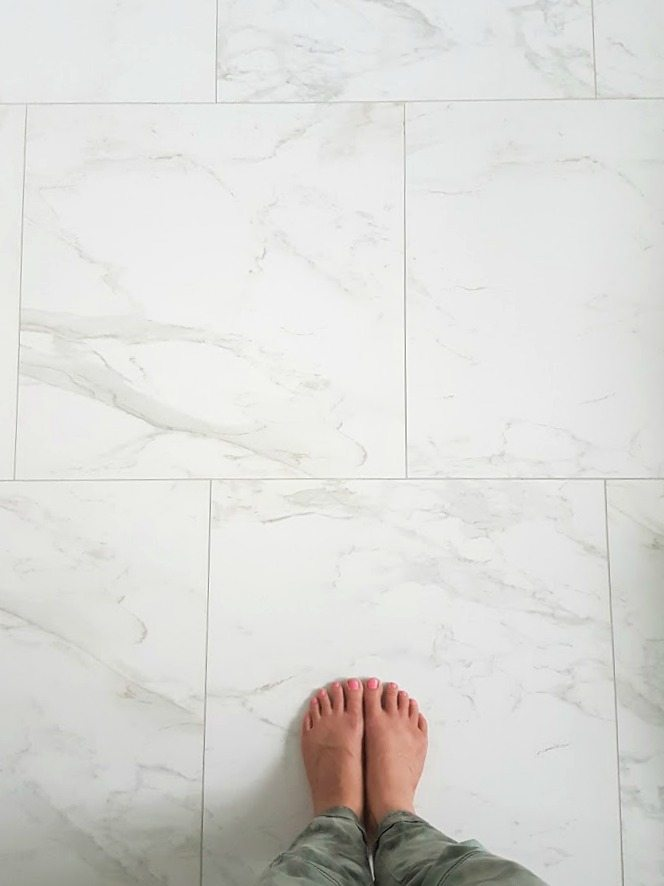 Choosing faux carrara marble floor tile for the bathroom for How to clean marble tiles in bathroom