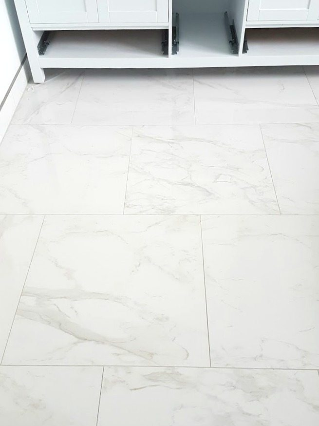 choosing faux carrara marble floor tile for the bathroom 19394