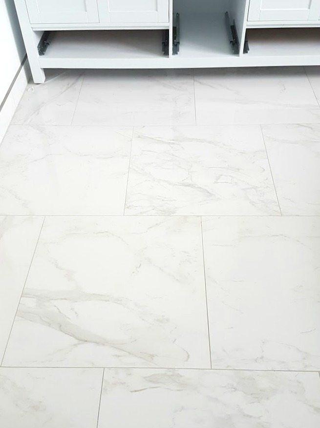 Choosing Faux Carrara Marble Floor Tile For The Bathroom