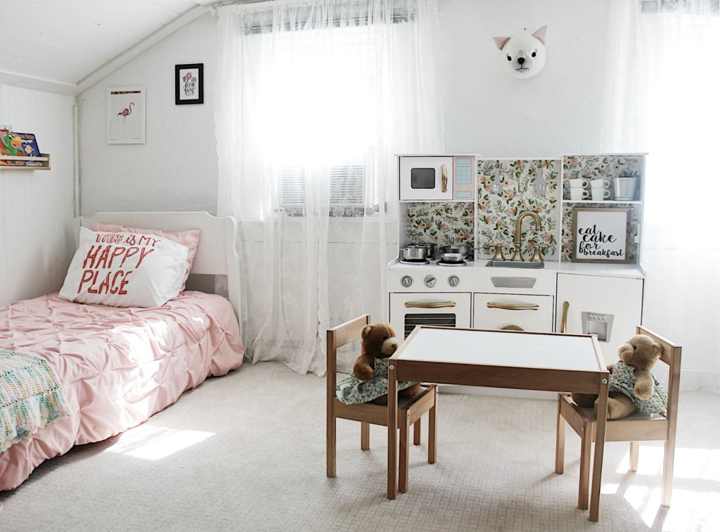 Little girls bedroom with customized play kitchen