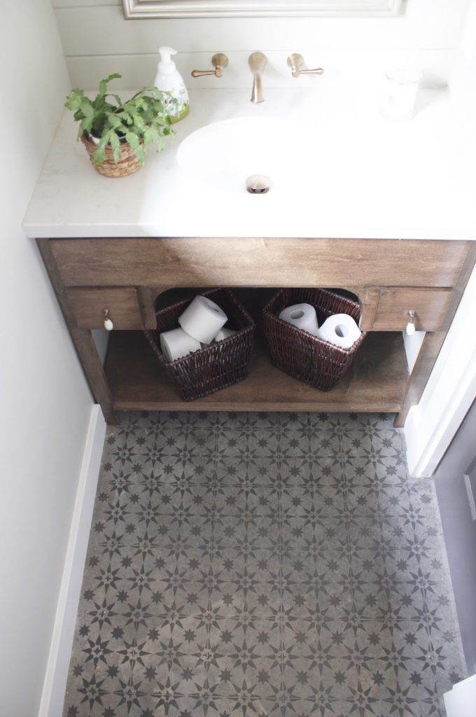 DIY Stenciled bathroom floors! Have concrete floors in your house? Try this DIY project to get the pattern tile look for less!