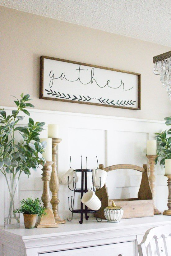 Get the cozy farmhouse look for Fall by layering in neutrals, a thanksgiving sign, and greenery.