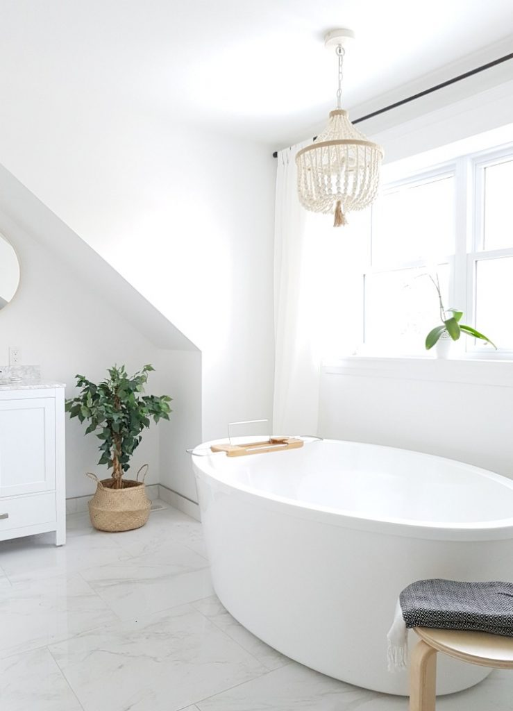 A #Modern #Marble #Bathroom with a #Spa Like Feel. #White with #Black #Faucets - on a budget. Get the look - I'm sharing all the sources in the blog post!