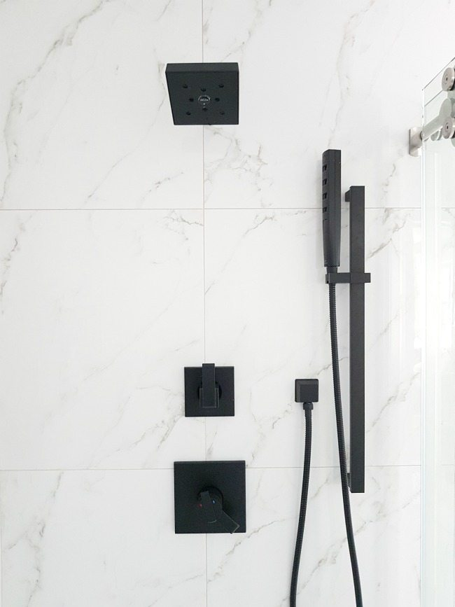 A #marble #shower featuring #matte #black #faucet. Get this #modern #spa #bathroom look for less!