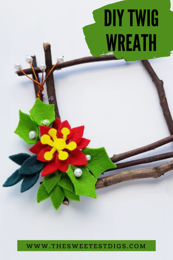 Christmas  wreath made from twigs and felt flowers.