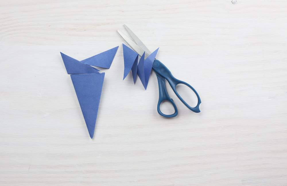 Folded paper flower with points cut off