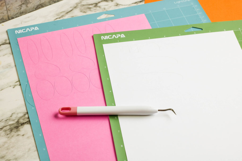 Cut shapes on paper with a weeding tool.