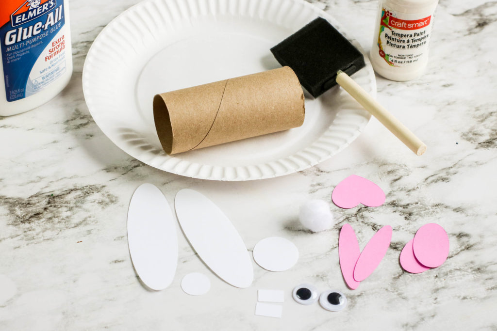 Craft materials needed to make a toilet roll Easter bunny.