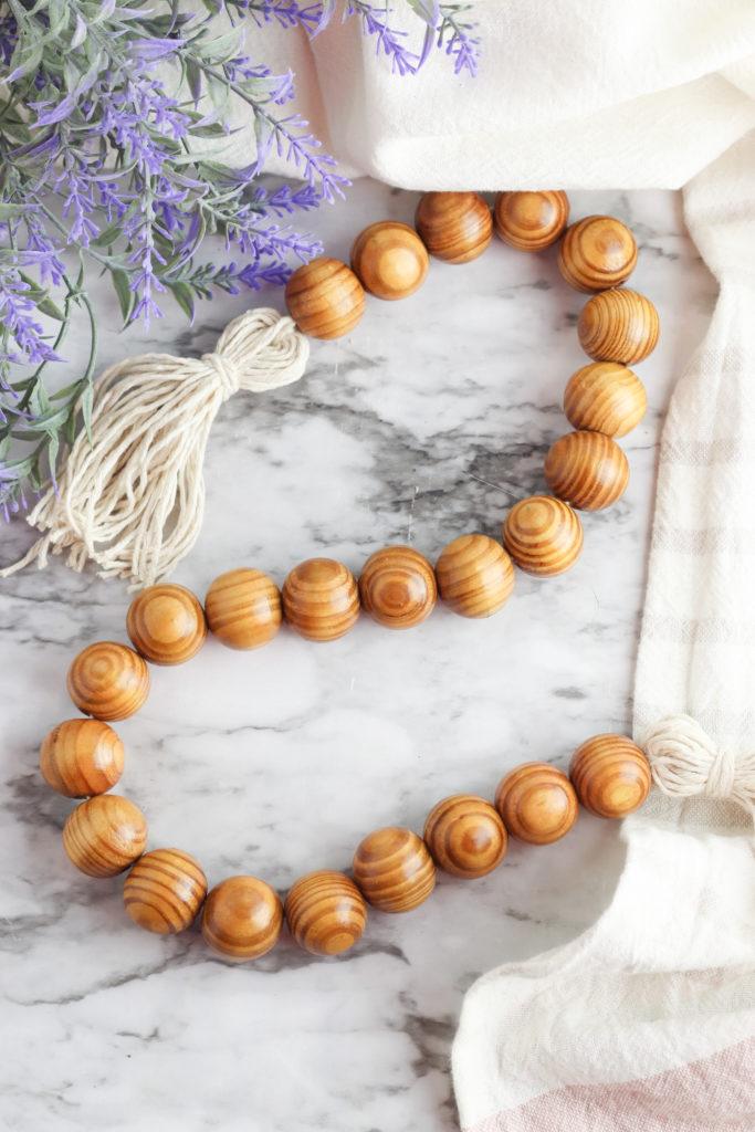 Finished wood bead tassel garland