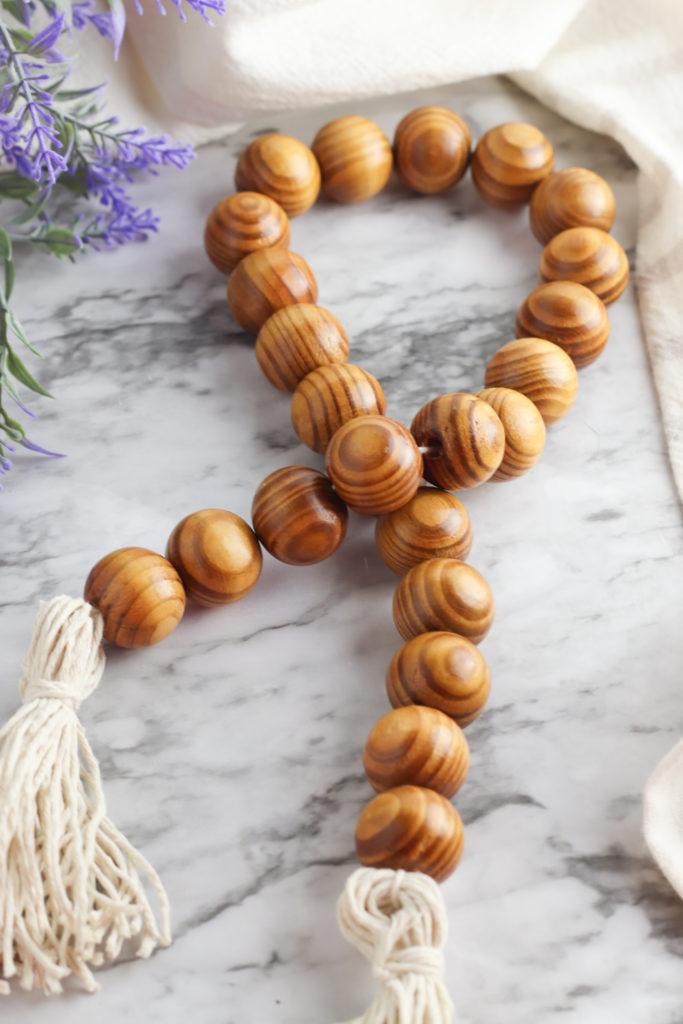 Finished wood bead tassel garland.