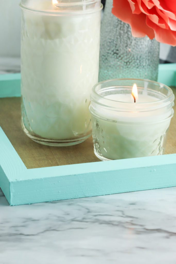Painted wood tray with candles.
