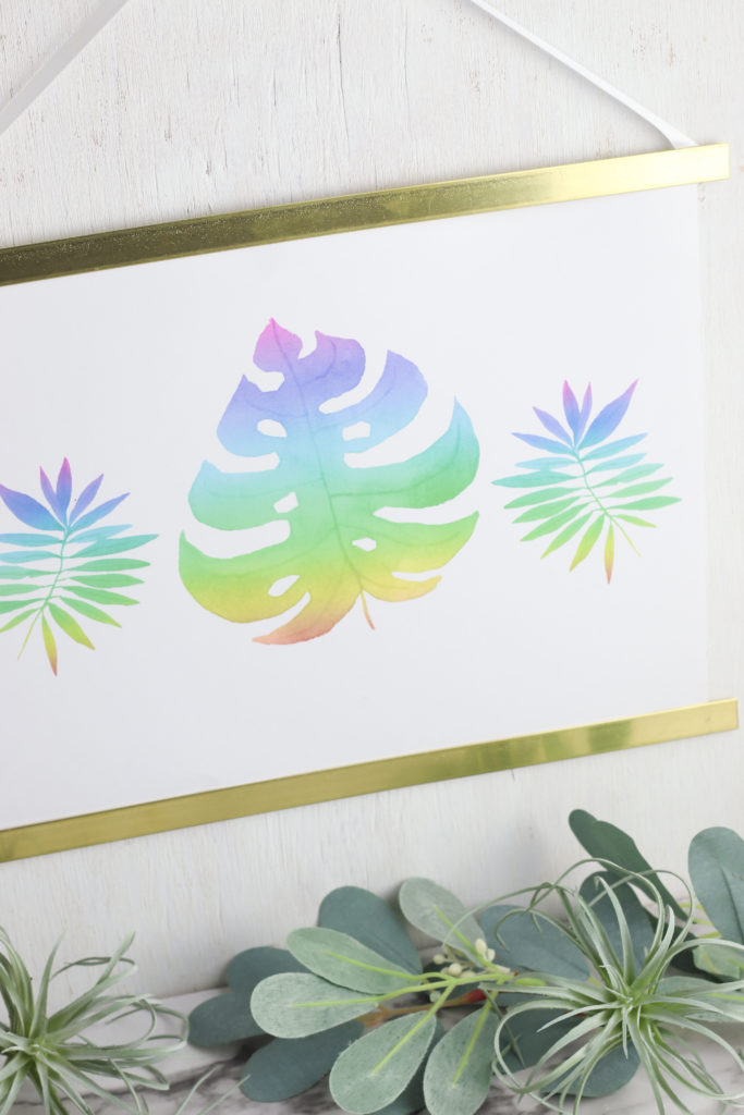 Close up of palm leaf watercolor wall hanging.