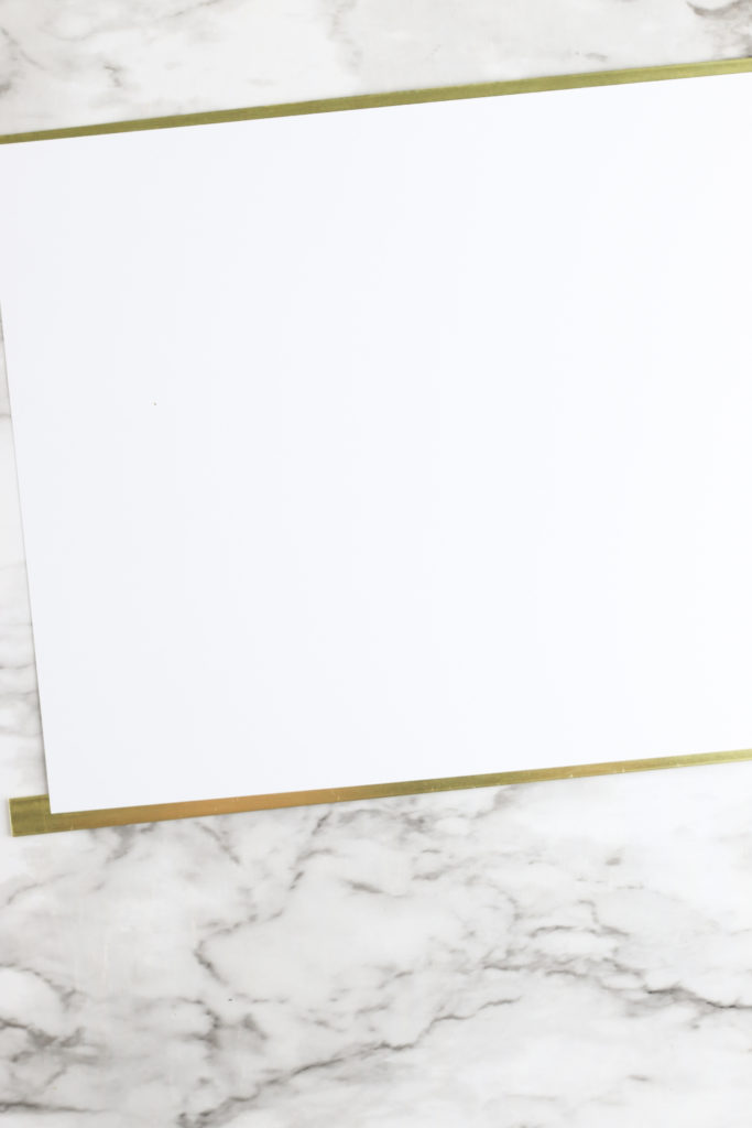 Gluing brass bars to the top and bottom of the watercolor printable.
